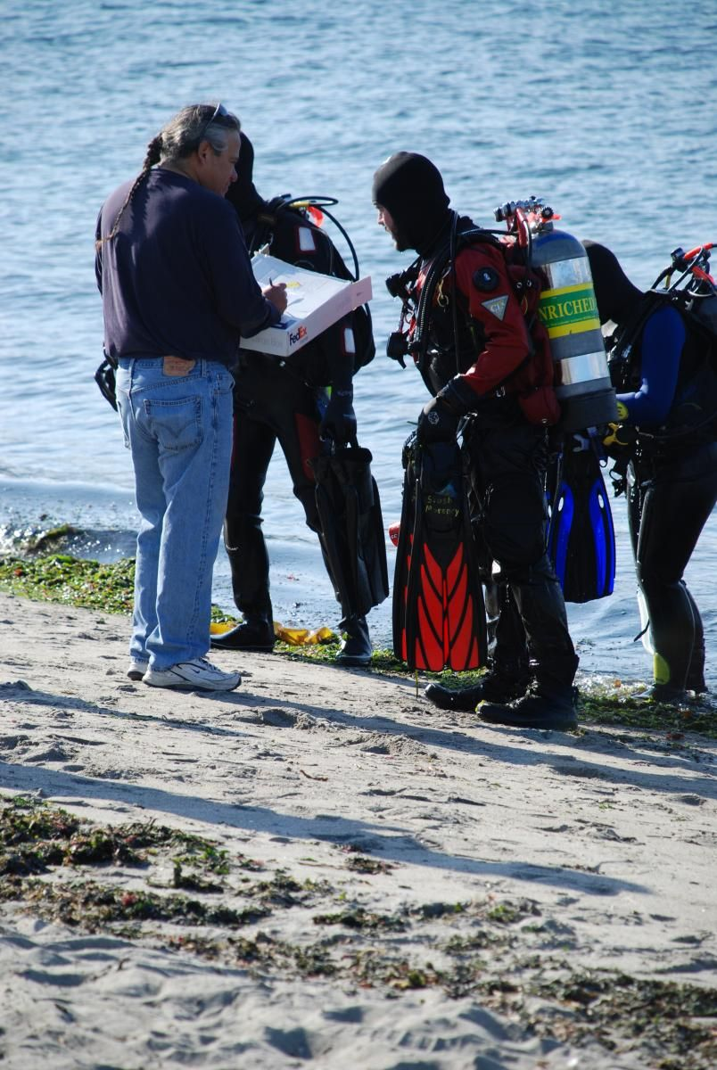 Divers checking in at shore after dive